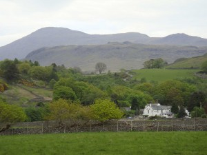 The Boot Inn in Eskdale in the English Lake District with Scafell behind.