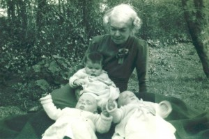Twins aged 5 months on the ground with their cousin Susan Bradburn also 5 months and their Grandmother Dorothy (Small) Hunter.